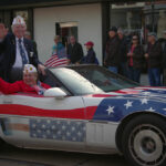Vets in american flag car